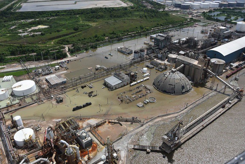 A flooded industrial plant in a Texas port. US Coast Guard flyover image. Courtesy of Creative Commons.